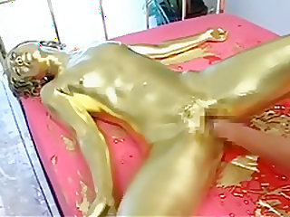 Japanese girl gets painted into gold and fisted