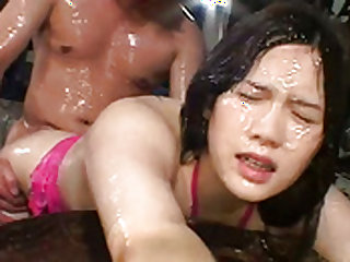 Naughty Asian milf is oiled and fucked wildly