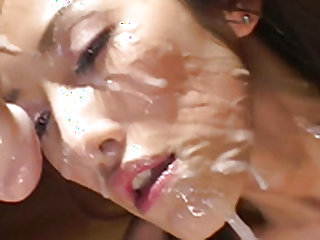 Foxy brunette gets warm facial after giving head