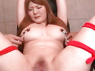 Asian chick gets her big tits and cunt pleasured with toys
