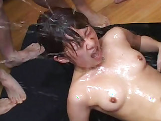 Horny asian gets filled with piss