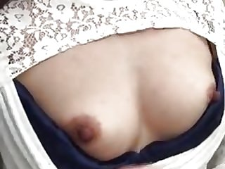 Japanese milf shows boobs